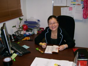 "Nancy looking busy in her ""dungeon"" office."