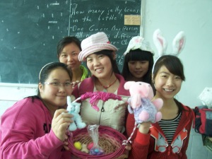 During the break, students pose with our visual aids for Easter:  bonnets, colored eggs, bunnies and the Easter basket.
