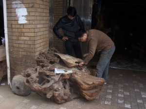 A traditional Chinese furniture maker at work.