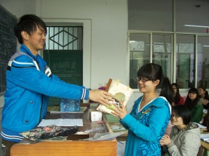 In yet another 1st year class, Tom (our only male, out of 44 girls) presents a gift to his classmate.