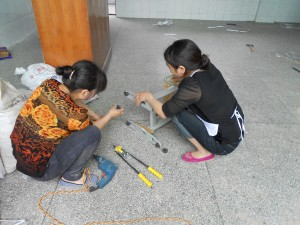 Our women workers, assembling the chairs.