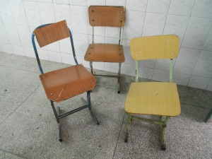 Our  classroom chairs , after years of abuse