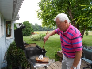 Charles (Chuck) Wieck, my dad's younger brother, at the grill.