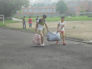 Upper classmen drag  their stored belongings back to the dormitories, with a little help from friends.