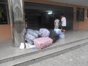 Some students arriving by bus had their luggage  from home picked up by campus trucks  at the station and delivered to their dorms.