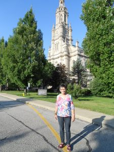 My mother on the campus, in front of St. Mary's 1876 church.
