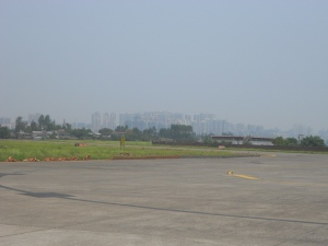 The first runway in China, with distant Luzhou in the background.