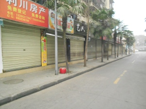 The stores along our alleyway sidestreet were closed up tight during the first few days of Spring Festival.