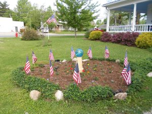 Many of us decorate our yards with flags.  This is my parents' front lawn, as we are getting ready to drive to the American Legion.