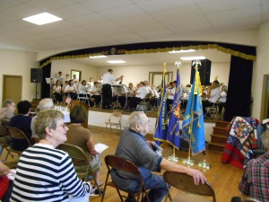 The Marshall City Band plays throughout the service, both festive marches and more solemn numbers.