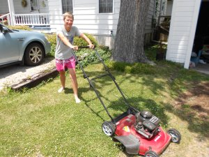 The new mower (For my Chinese audience:  Don't mow in bare feet! I'm just posing for the photo.)