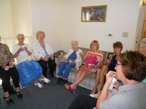 Fellowship time after the service includes lots of coffee and cookies.  Gals to the left of the room . . .