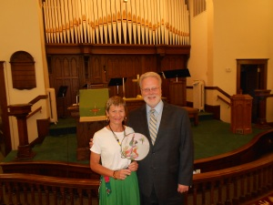 "At Reynolds UMC, considered the ""city"" church, Pastor Paul Newhall and I pose for a picture in the sanctuary."