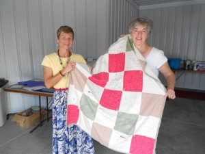 I'm presented with a handmade prayer quilt.  Perfect to keep me warm on those chilly Sichuan evenings.
