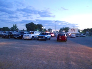 At 8:30 p.m., the high school parking lot begins to fill with those waiting for our 9:15 show to begin