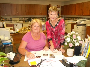 Kelley Ray (seated) and me going over the last touches of my summer newsletter in the church office.