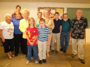 Luncheon at Woodside UMC, with Pastor Linda in yellow jacket.