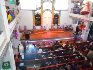 Getting ready for Christmas Eve worship:  The Luzhou Protestant Church (1913)