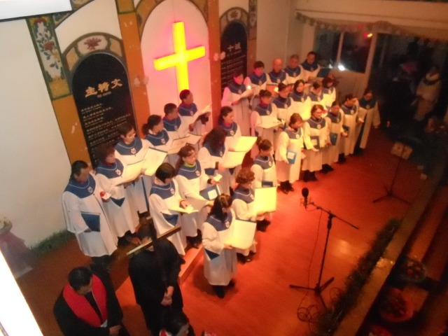 Our choir members sing Silent Night during the opening worship.