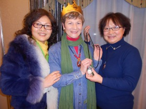 Ms. Liu (left), who ordered all our dishes, and Cathy, presenting me with a birthday necklace.