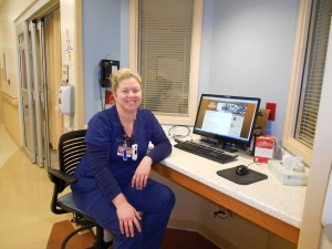 Ashley, one of my dad's ICU nurses, at her station outside my dad's room.  Excellent care-giver!