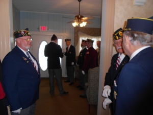 Members of my dad's honor guard gather in the outer room before my dad's memorial service