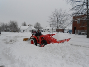 Our church men, out early to plow out car-parking for those who dared drive to worship.