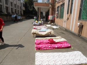 On a sunny day, outside college dormitories all across China you'll see students airing out their musty bedding in the bright sunshine.