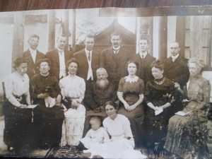 The China Inland Mission Canadian Methodist missionaries, including Luzhou church founders, Rev. Charles Joliffe (standing third from the left) and his wife, Gertrude (seated second from right, looking down at child)
