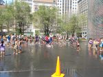 Children of all ages enjoy frolicking in the fountain waters on a hot day.  Millennium Park is the Park of the People.