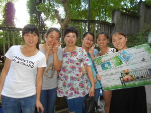 The Wang's daughter (center) with students came to finish cleaning everything out.