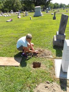 After the ashes were placed in the ground, my mom, brother and I put in a handful of dirt.