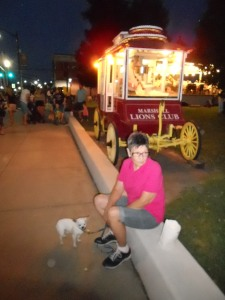 My mom and Lao-lao take a rest beside the popcorn wagon