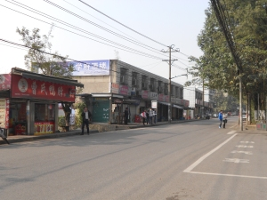 Wa Yao Ba Road. The shop keepers in the building seen here were forced to move out to widen the road.