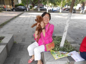 Mrs. Zhao and her poodle, Hairy Bean, on the campus of Sichuan University in Chengdu