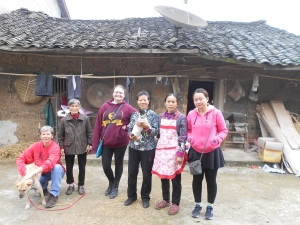 SP and her New Farming Family.  From left to right:  Me, SP, Grandma, Jackie (Peace Corp volunteer), Teacher Xue and Little Sister (she helped find SP a home), Mother Chen and Cici (Teacher Xue's colleague)
