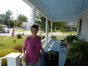 Saying Goodbye: My mom on our front porch with my suitcase