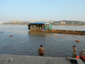 The Yangtze River was full of swimmers. Safety floaties for 30 yuan ($5) a day could be rented at a teahouse for swimmers.